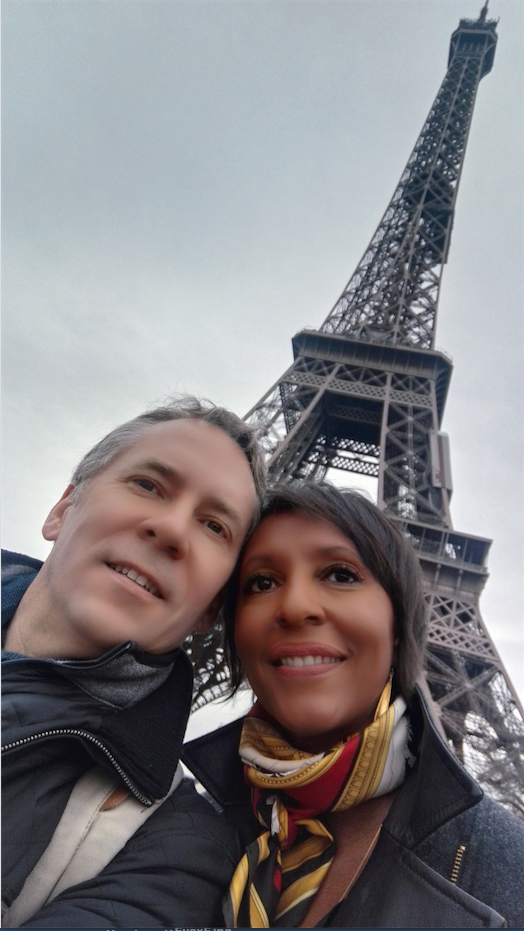 eva medilek and husband in front of tower