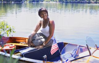 relationship coach eva medilek sitting in a boat